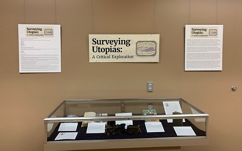 The introductory wall and case to the Surveying Utopias: A Critical Exploration's Special Collections exhibition in Henry Madden Library, California State University, Fresno.