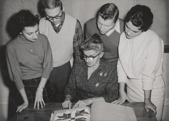 Professor Mary Celestia Parler with University of Arkansas students reviewing Ozark folklore materials, ca 1950s.