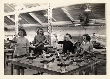 Four women with model airplanes
