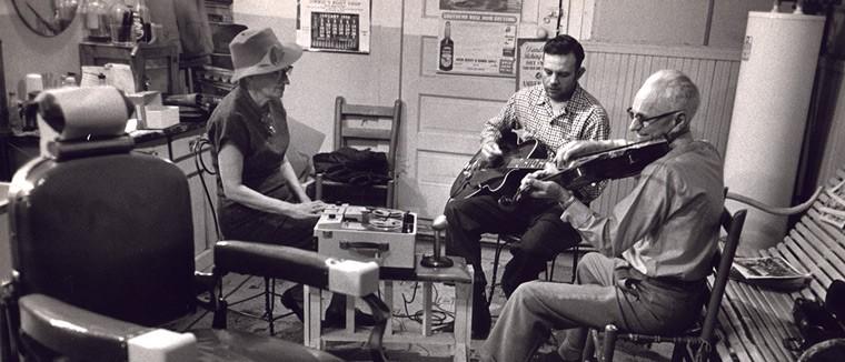 Mary Celestia Parler recording Fred C. Smith and an unidentified musician in Oriole Barber Shop, Bentonville, Arkansas, ca. 1950 - Ozark Folksong Collection