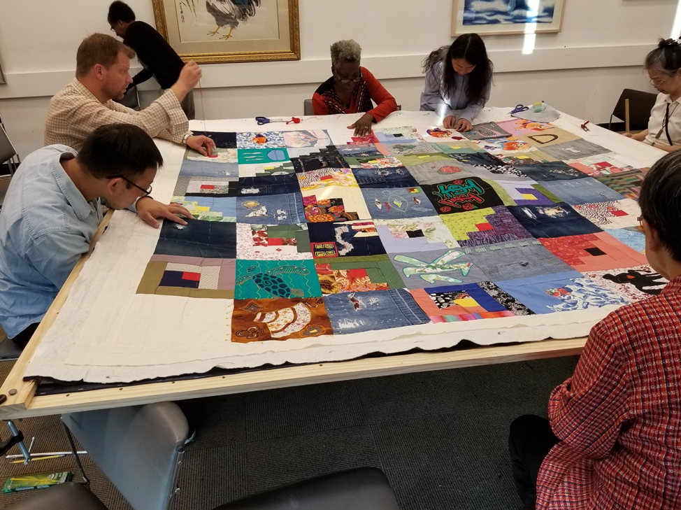 Image of Story Quilt maker workshop. Part of the Queens Memory Collection at the Archives at Queens Library.